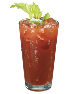 Bloody mary with tequila and celery in a tall glass.